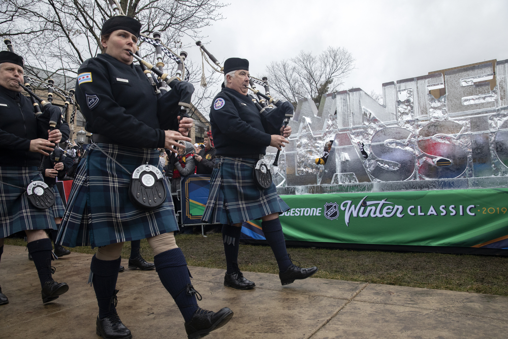 The Pipes and Drums of the Chicago Police Department play as they lead the Chicago Blackhawks players to Notre Dame Stadium before the Winter Classic outdoor hockey game between the Blackhawks and Boston Bruins Tuesday, Jan. 1, 2019, in South Bend, Ind. (Erin Hooley/Chicago Tribune)