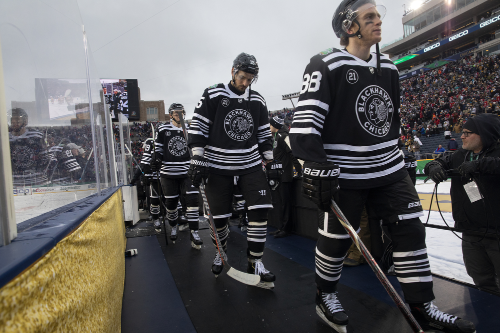 Chicago Blackhawks right wing Patrick Kane (88) and the Chicago Blackhawks leave the ice after their loss to the Boston Bruins in the Winter Classic outdoor hockey game Tuesday, Jan. 1, 2019, at Notre Dame Stadium in South Bend, Ind. Boston won the game 4-2. (Erin Hooley/Chicago Tribune)