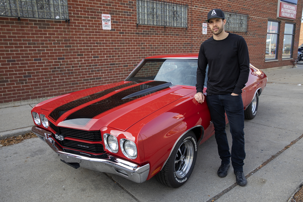 Chicago Blackhawks goaltender Corey Crawford stands with the 1970 Chevy Chevelle SS he restored with help from his friends at Nortown Auto LLC Monday, Nov. 19, 2018, in Chicago. He donated the car to the Chicago Blackhawks Foundation and fans can purchase raffle tickets at Blackhawks home games or online to enter the charity drawing for the car held February 18 2019. (Erin Hooley/Chicago Tribune)