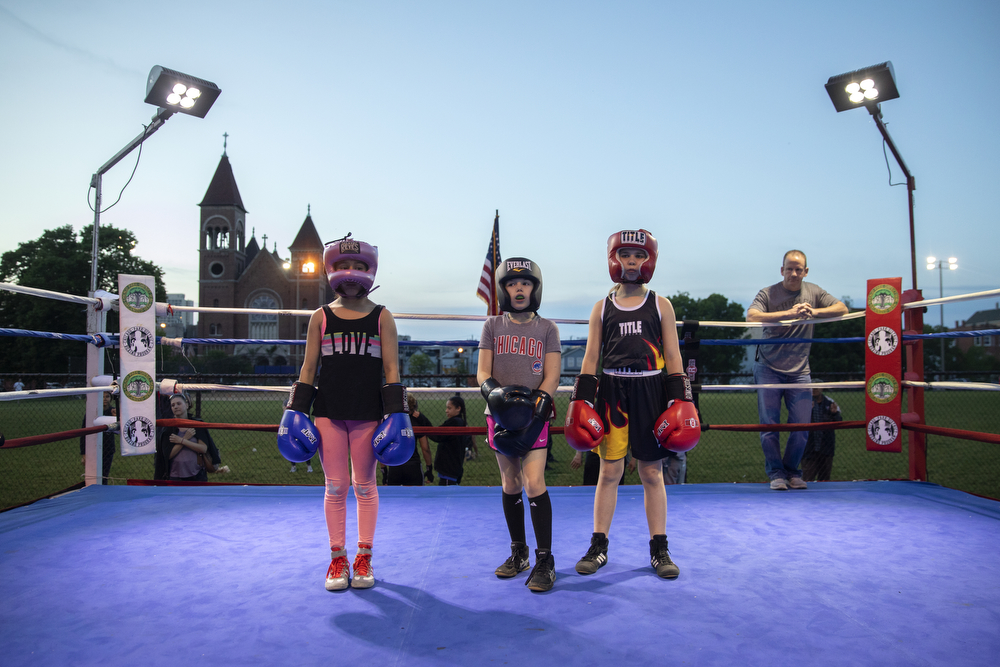 From left, 9-year-old Sherlyn Resendiz, 9-year-old Abigal Fleming of Brooks Boxing and 10-year-old Shannon Flannigan of Brooks Boxing prepare to spar at a women's-only boxing exhibition event Thursday, May 30, 2019, at Eckhart Park in Chicago. (Erin Hooley/Chicago Tribune)