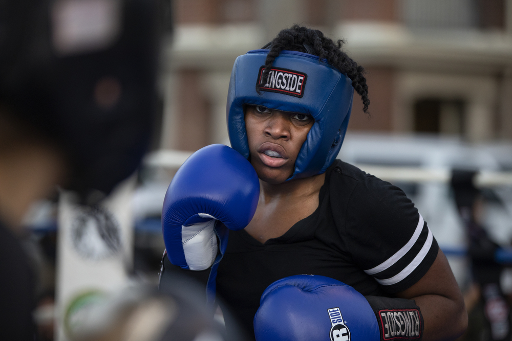 29-year-old Ashley Hiniker of Unanimous Boxing Gym, left, and 17-year-old Brianna Jordan of Ada Boxing spar at a women's-only boxing exhibition event Thursday, May 30, 2019, at Eckhart Park in Chicago. (Erin Hooley/Chicago Tribune)