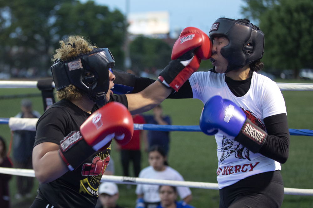 16-year-old Ja Leecia Dominguez of Hammond Boxing, left, spars with 26-year-old Denisse Baron of Rico's Boxing at a women's-only boxing exhibition event Thursday, May 30, 2019, at Eckhart Park in Chicago. (Erin Hooley/Chicago Tribune)