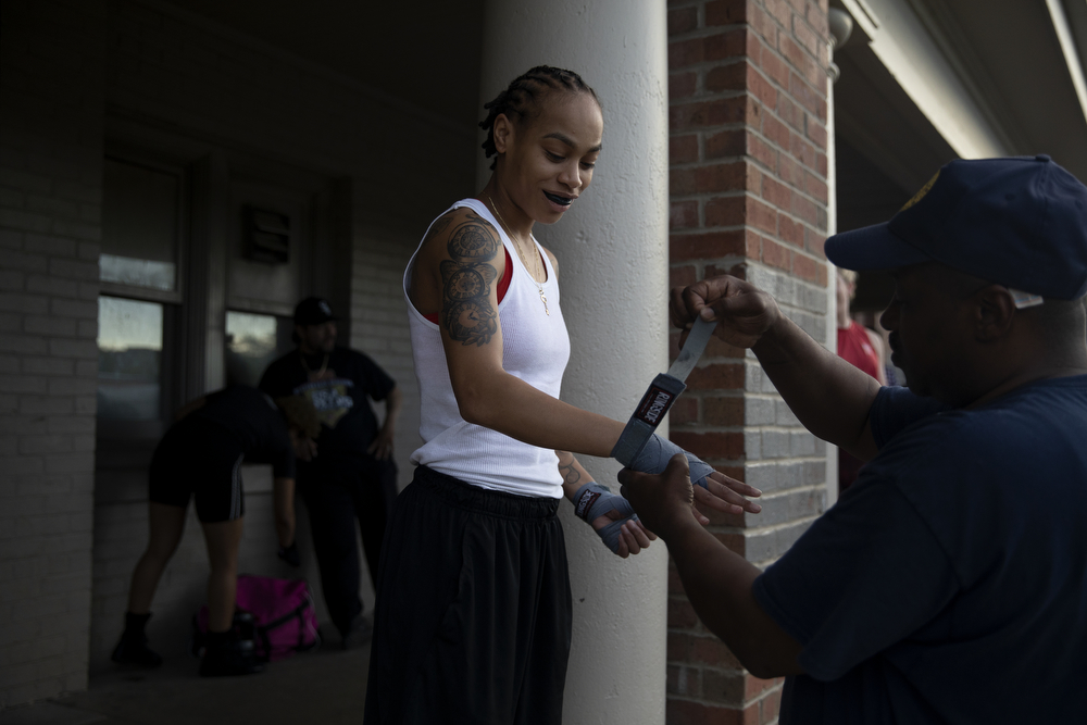 28-year-old Apiffany Rushing of Trumbull Boxing gets her hands wrapped before sparring at a women's-only boxing exhibition event Thursday, May 30, 2019, at Eckhart Park in Chicago. (Erin Hooley/Chicago Tribune)