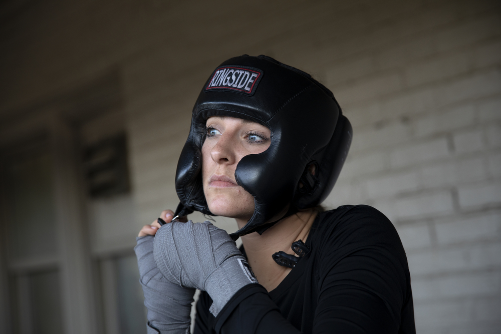 29-year-old Ashley Hiniker of Unanimous Boxing Gym prepares to spar at a women's-only boxing exhibition event Thursday, May 30, 2019, at Eckhart Park in Chicago. (Erin Hooley/Chicago Tribune)
