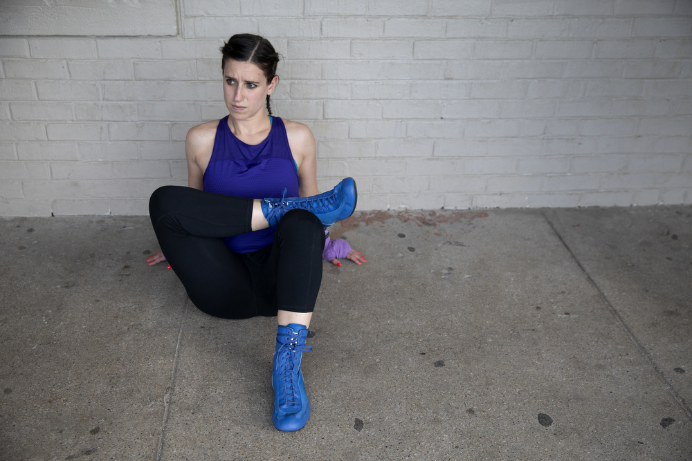 30-year-old Alyson MArkstein of Unanimous Boxing Gym stretches before sparring at a women's-only boxing exhibition event Thursday, May 30, 2019, at Eckhart Park in Chicago. (Erin Hooley/Chicago Tribune)