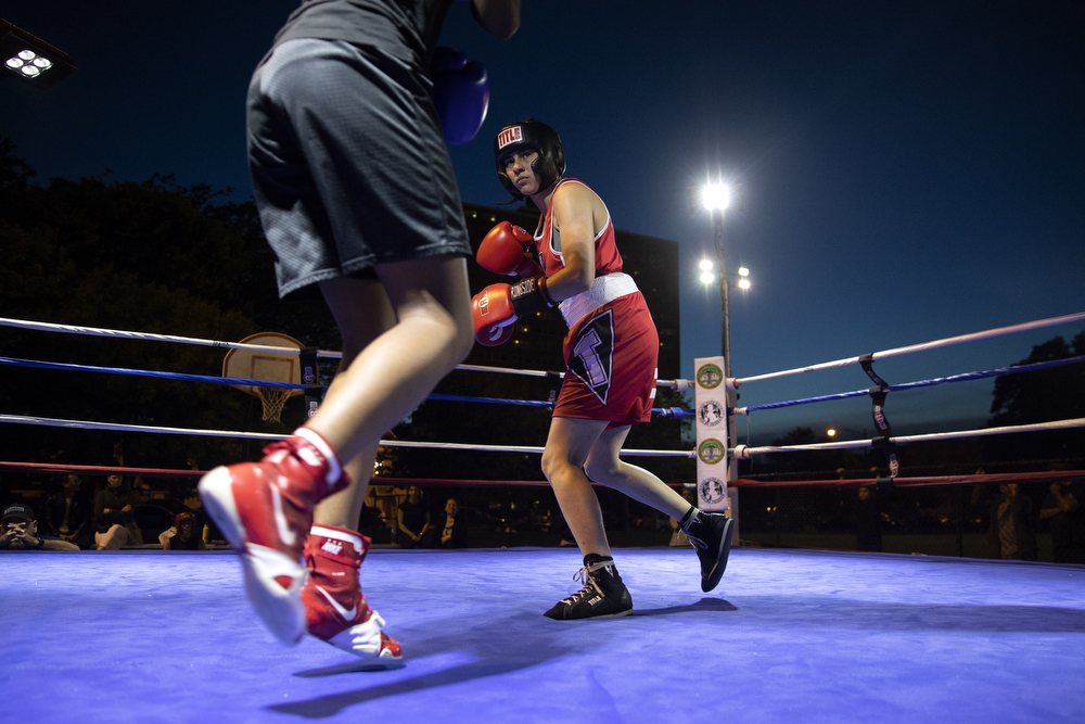 23-year-old Leila Elaqad of Simons Park Boxing, right, spars 17-year-old Brianna Jordan of Ada Boxing at a women's-only boxing exhibition event Thursday, May 30, 2019, at Eckhart Park in Chicago. (Erin Hooley/Chicago Tribune)