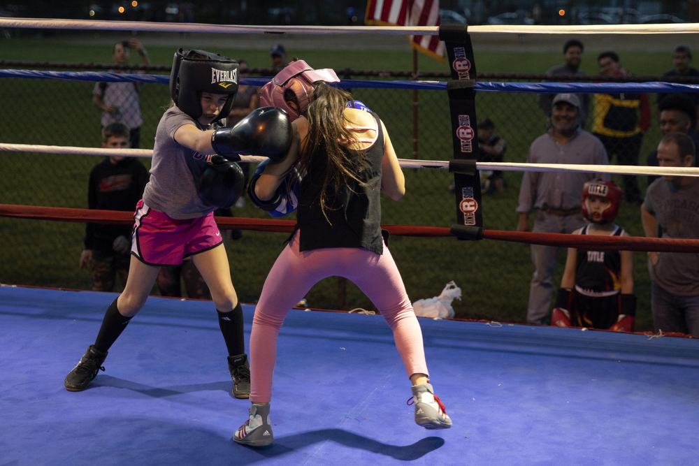 9-year-old Abigal Fleming of Brooks Boxing, left, spars with 9-year-old Sherlyn Resendiz at a women's-only boxing exhibition event Thursday, May 30, 2019, at Eckhart Park in Chicago. (Erin Hooley/Chicago Tribune)