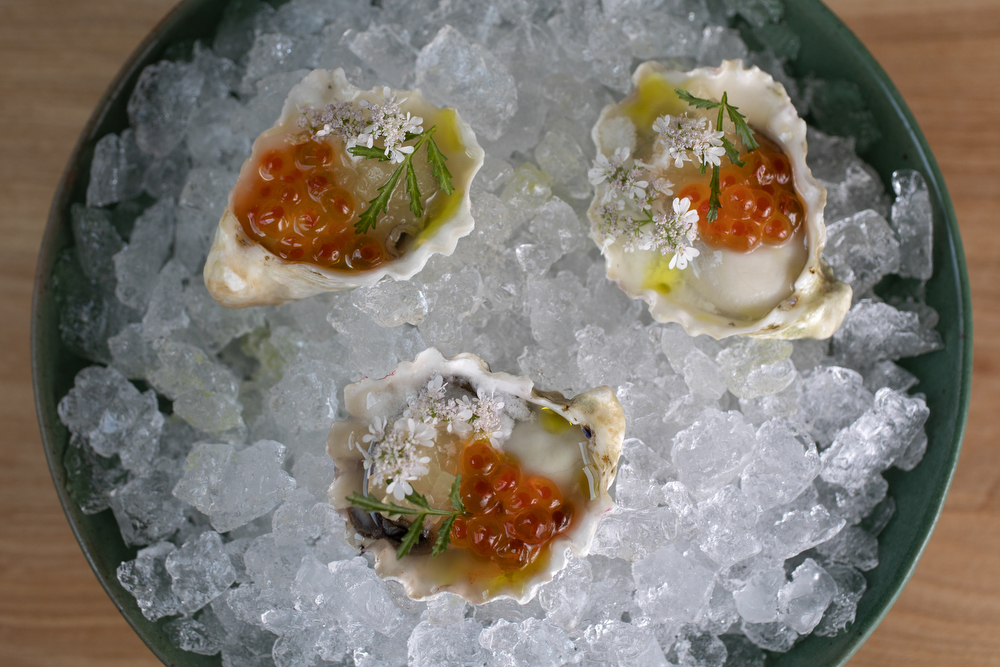 Oysters with rice granita, coriander, compressed melon and smoked trout roe are on the menu at Kumiko restaurant Tuesday, July 9, 2019, in Chicago. (Erin Hooley/Chicago Tribune)