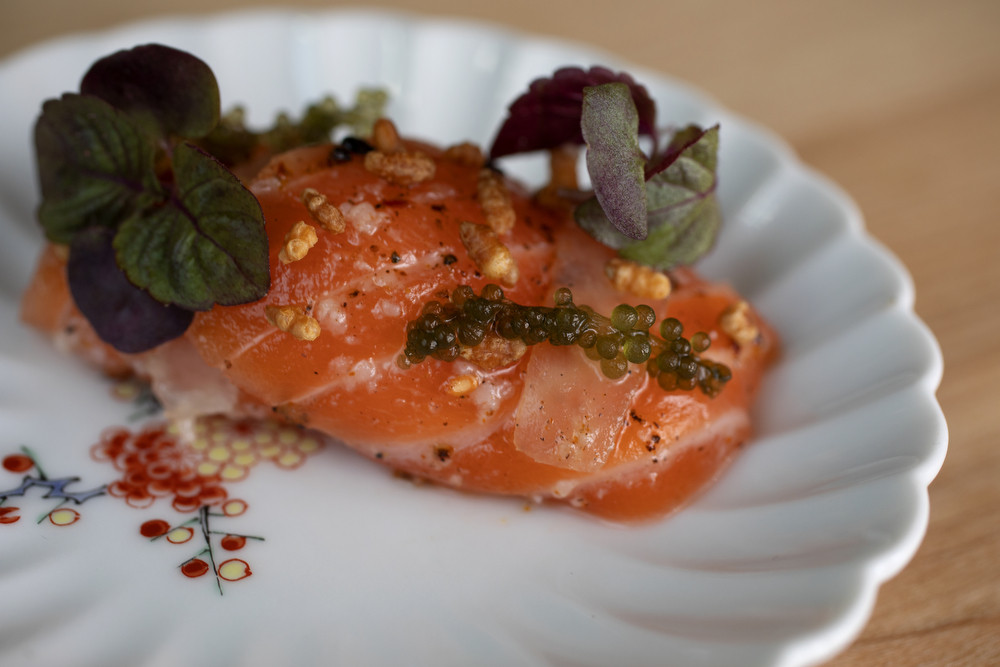 Sashimi ora king salmon with torched lardo, sea grape and toasted genmai is on the menu at Kumiko restaurant Tuesday, July 9, 2019, in Chicago. (Erin Hooley/Chicago Tribune)
