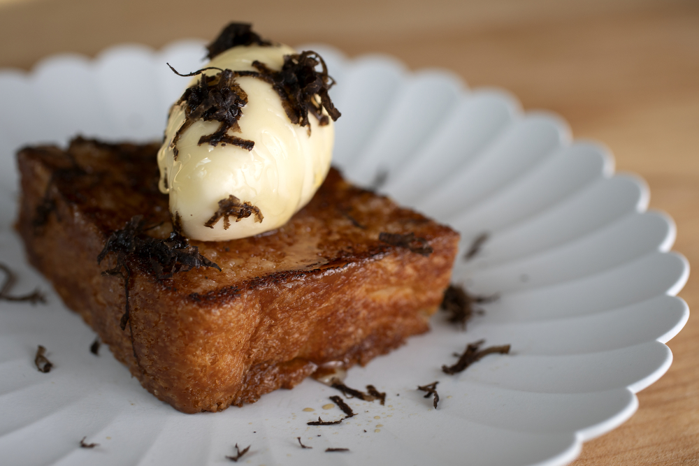 Japanese milk bread with fermented honey ice cream and truffle is on the menu at Kumiko restaurant Tuesday, July 9, 2019, in Chicago. (Erin Hooley/Chicago Tribune)