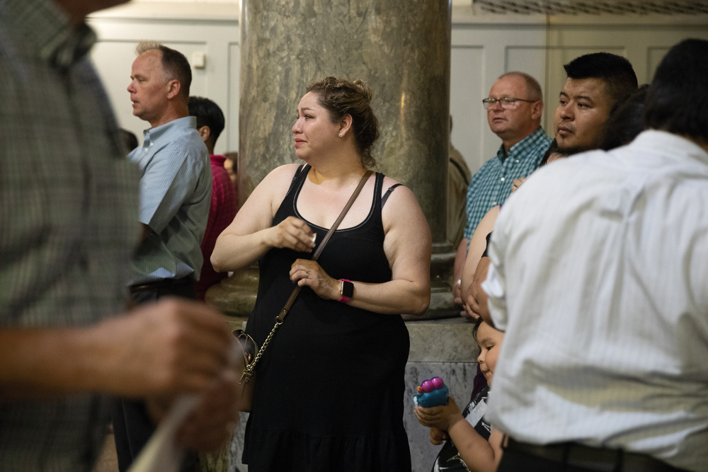 "Cecilia Abraham is emotional during may be the final mass held at St. Adalbert's Catholic Church Sunday, July 14, 2019, in the Pilsen neighborhood of Chicago. She's attended the church for 15 years. A decree from the Archdiocese of Chicago declared the last mass was to take place on July 14. In a press release, the St. Adalbert Preservation Society stated that although a petition to keep the church open was ""rejected by the Cardinal and the officers of the Archdiocese of Chicago in a letter and decree dated July 8, 2019,"" it will now take the petition to the Vatican. (Erin Hooley/Chicago Tribune)"
