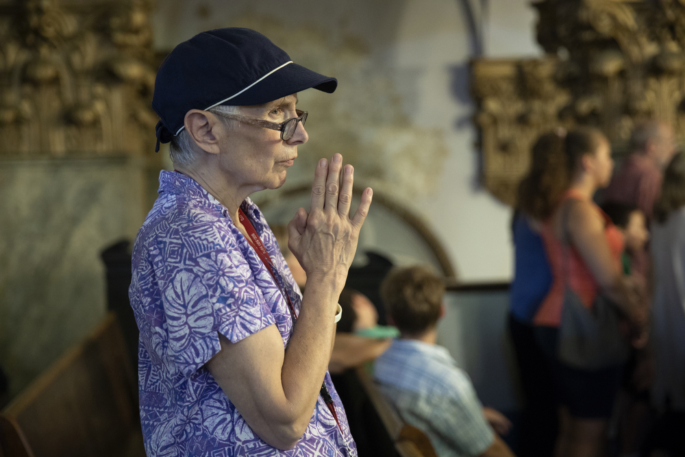 "A woman holds her hands in prayer during what may be the final mass held at St. Adalbert's Catholic Church Sunday, July 14, 2019, in the Pilsen neighborhood of Chicago. A decree from the Archdiocese of Chicago declared the last mass was to take place on July 14. In a press release, the St. Adalbert Preservation Society stated that although a petition to keep the church open was ""rejected by the Cardinal and the officers of the Archdiocese of Chicago in a letter and decree dated July 8, 2019,"" it will now take the petition to the Vatican. (Erin Hooley/Chicago Tribune)"