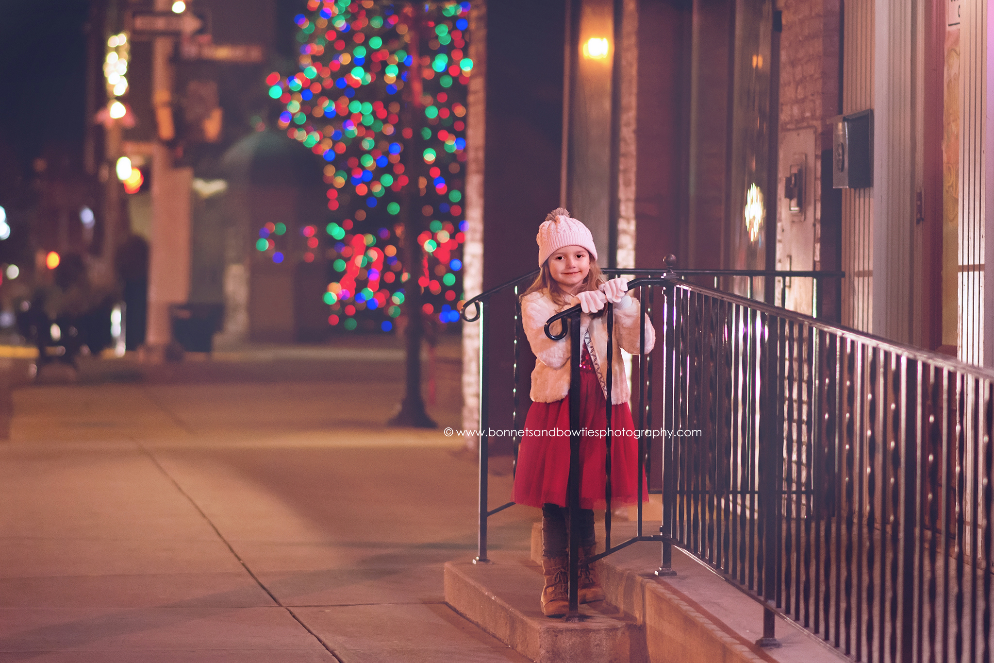 Little Girl in the City read dress and Christmas tree
