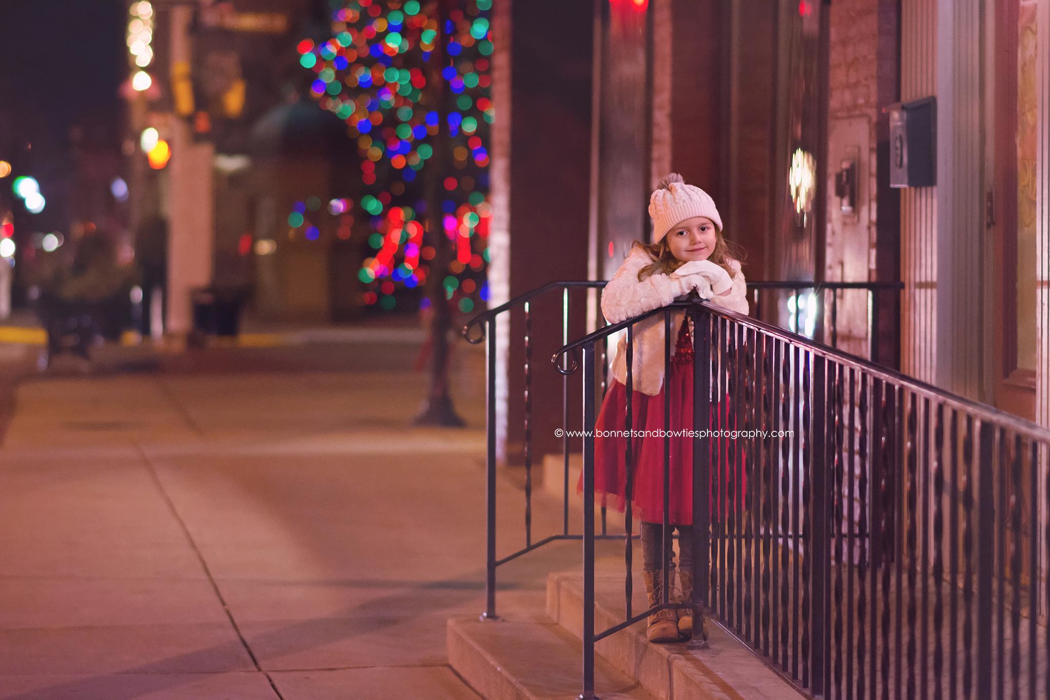 little girl modeling red dress in York City