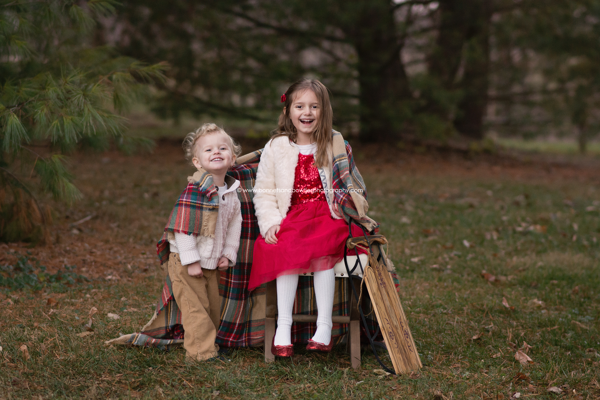 Christmas portrait girl and boy red dress