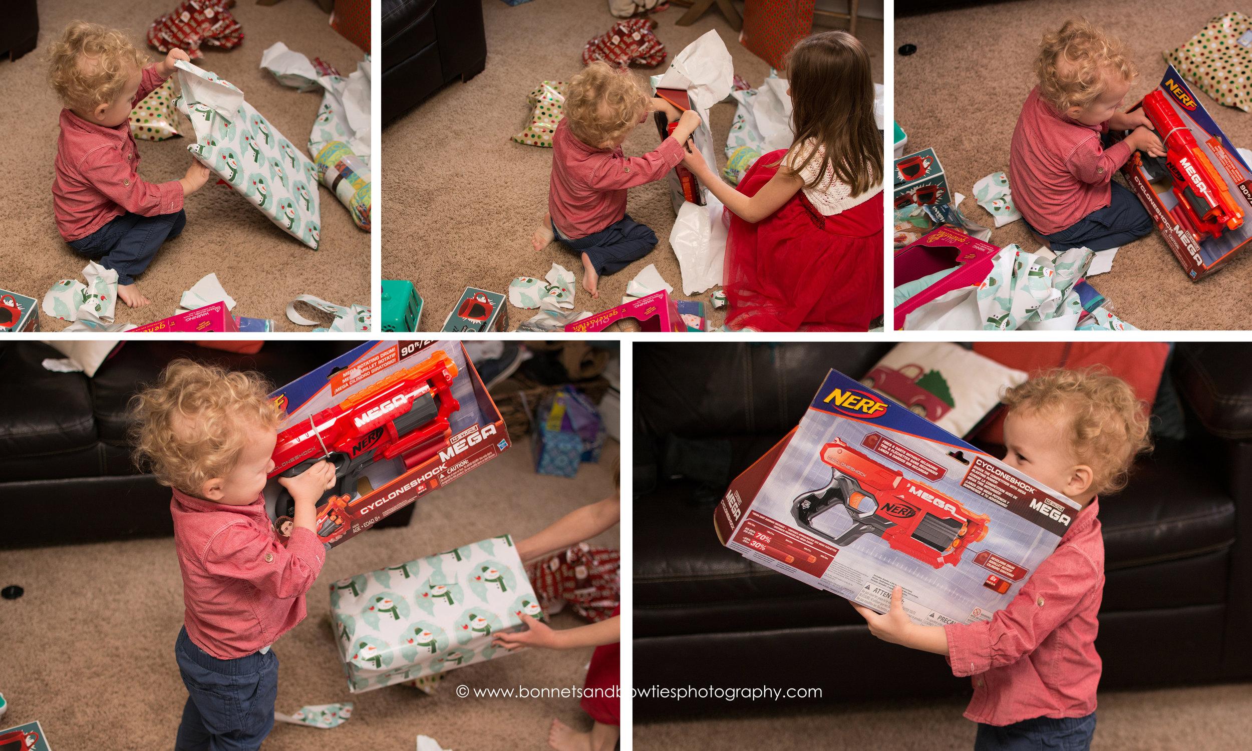 little boy opening nerf gun on christmas day.jpg