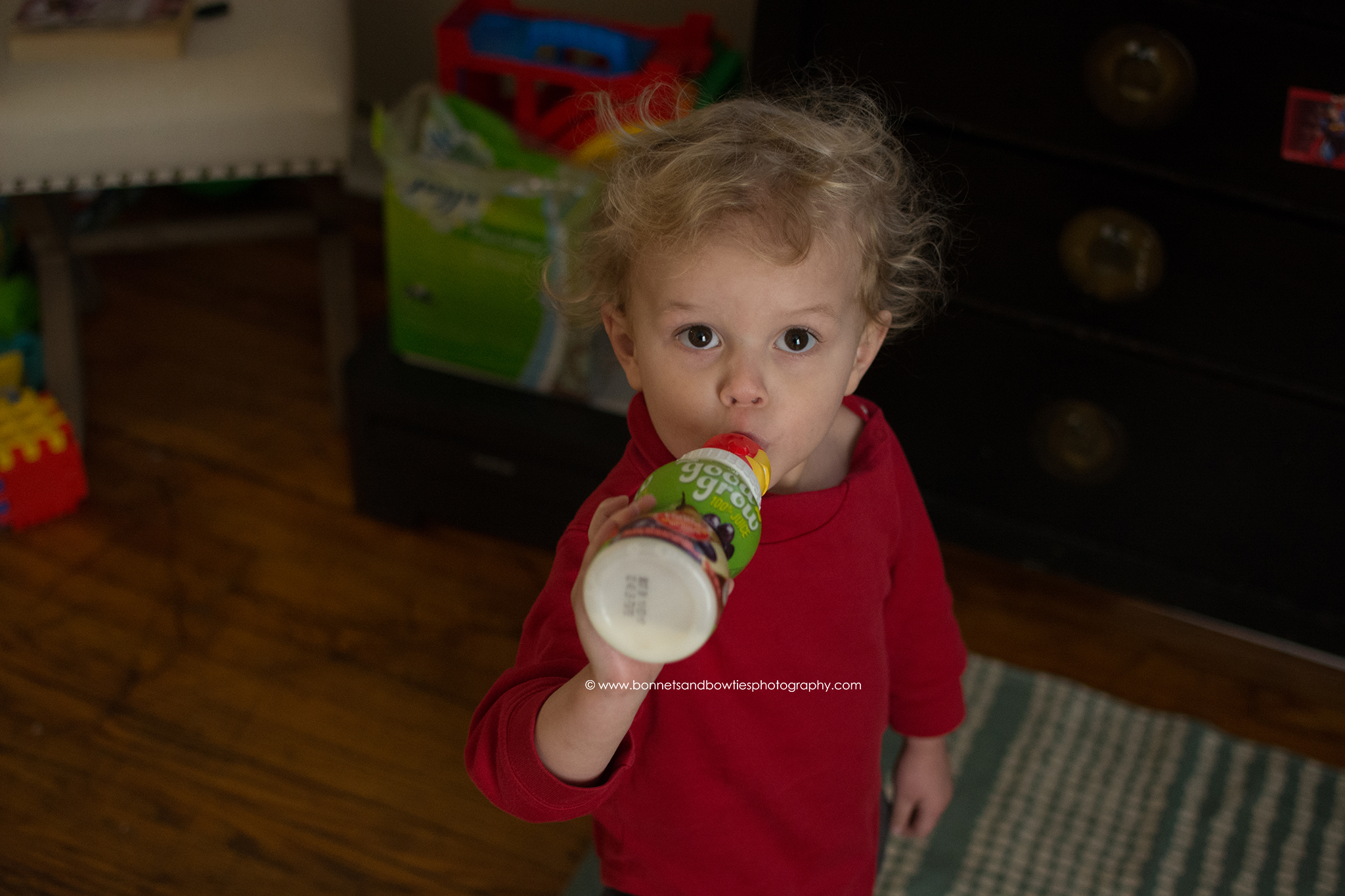 toddler drinking a sippy