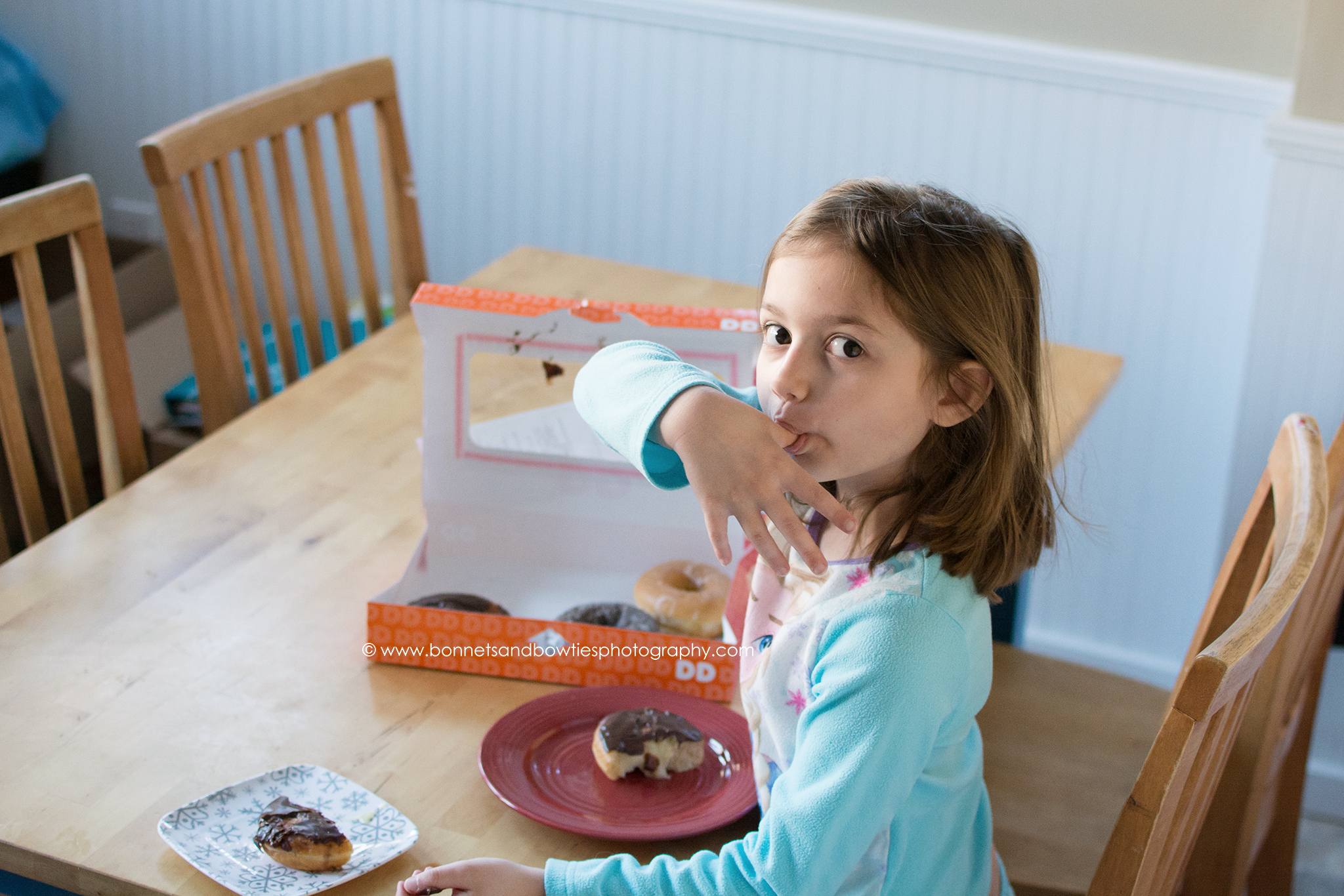 little girl eating a doughnut lifestyle