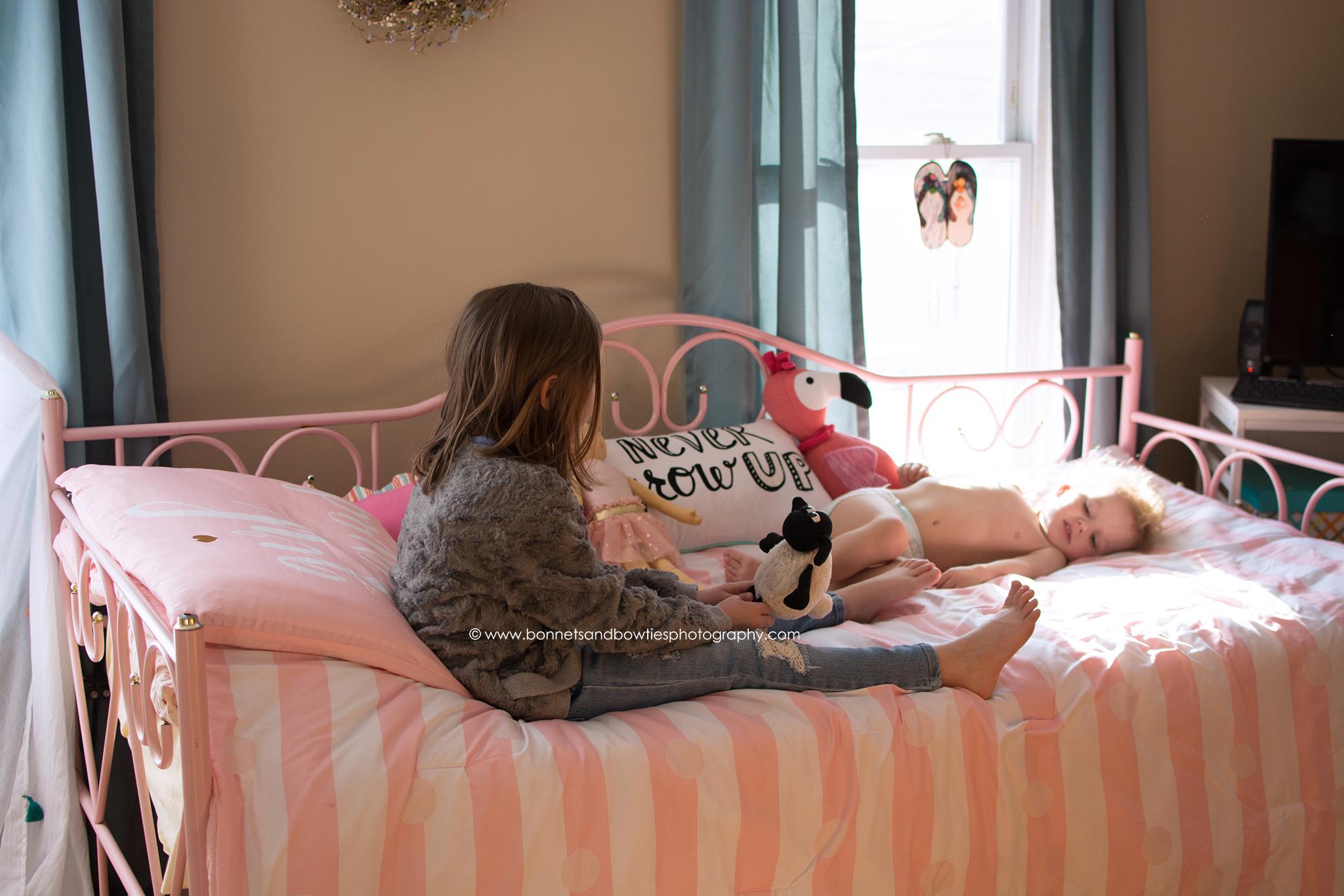 little girl reading in room
