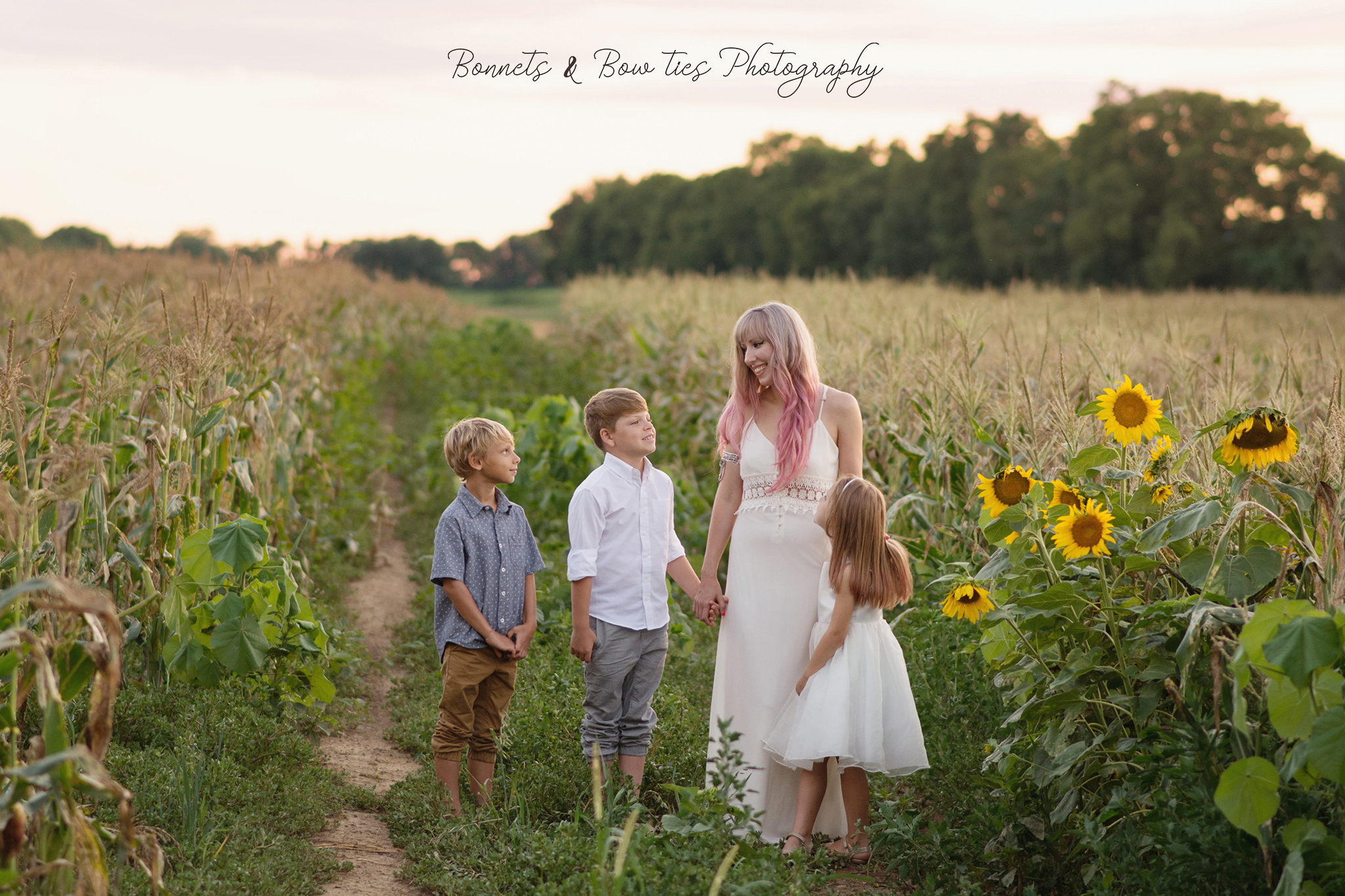 mother and three children pose in corn field in york pa