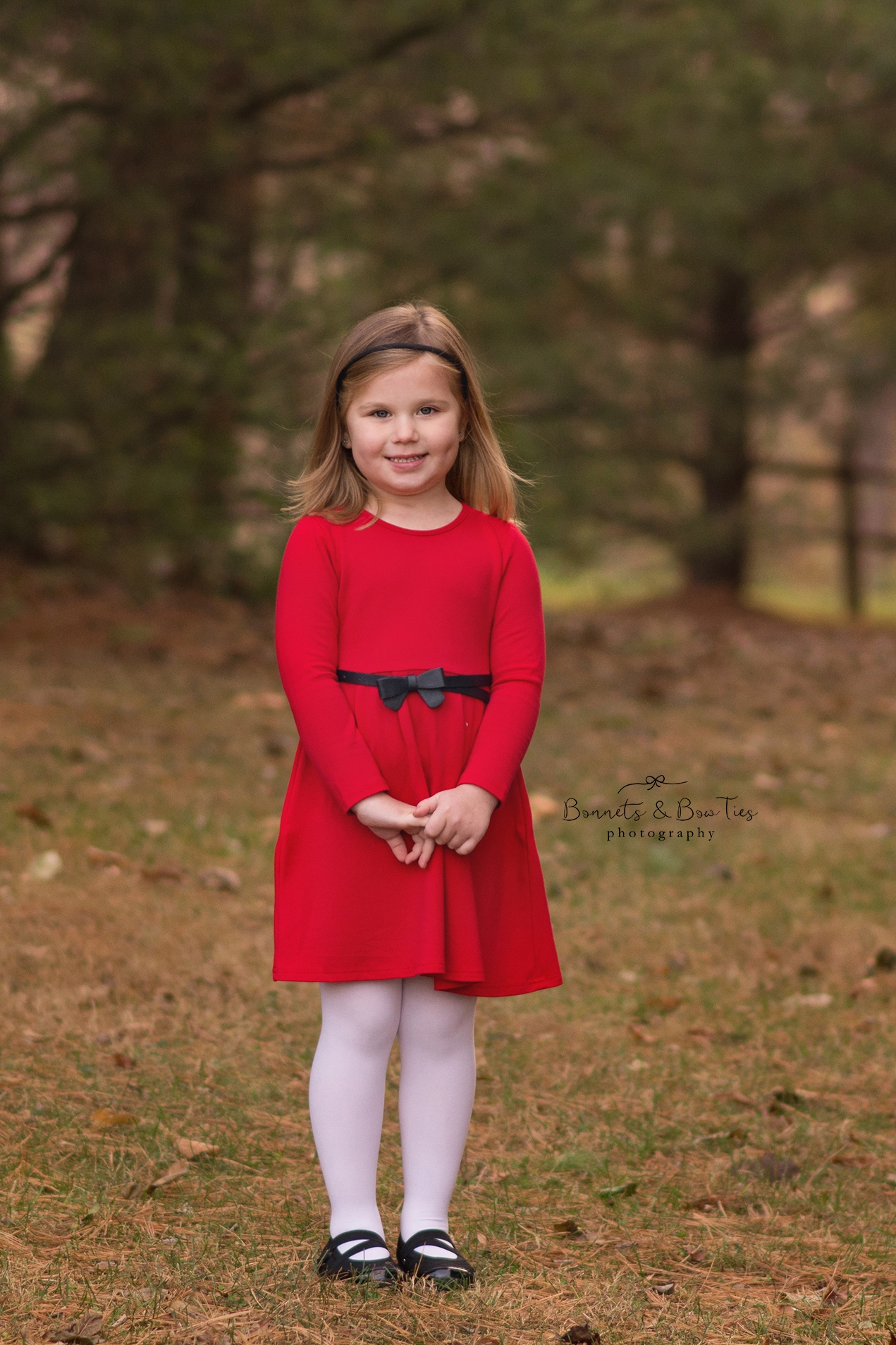 Little girl wearing red in Christmas portrait.jpg