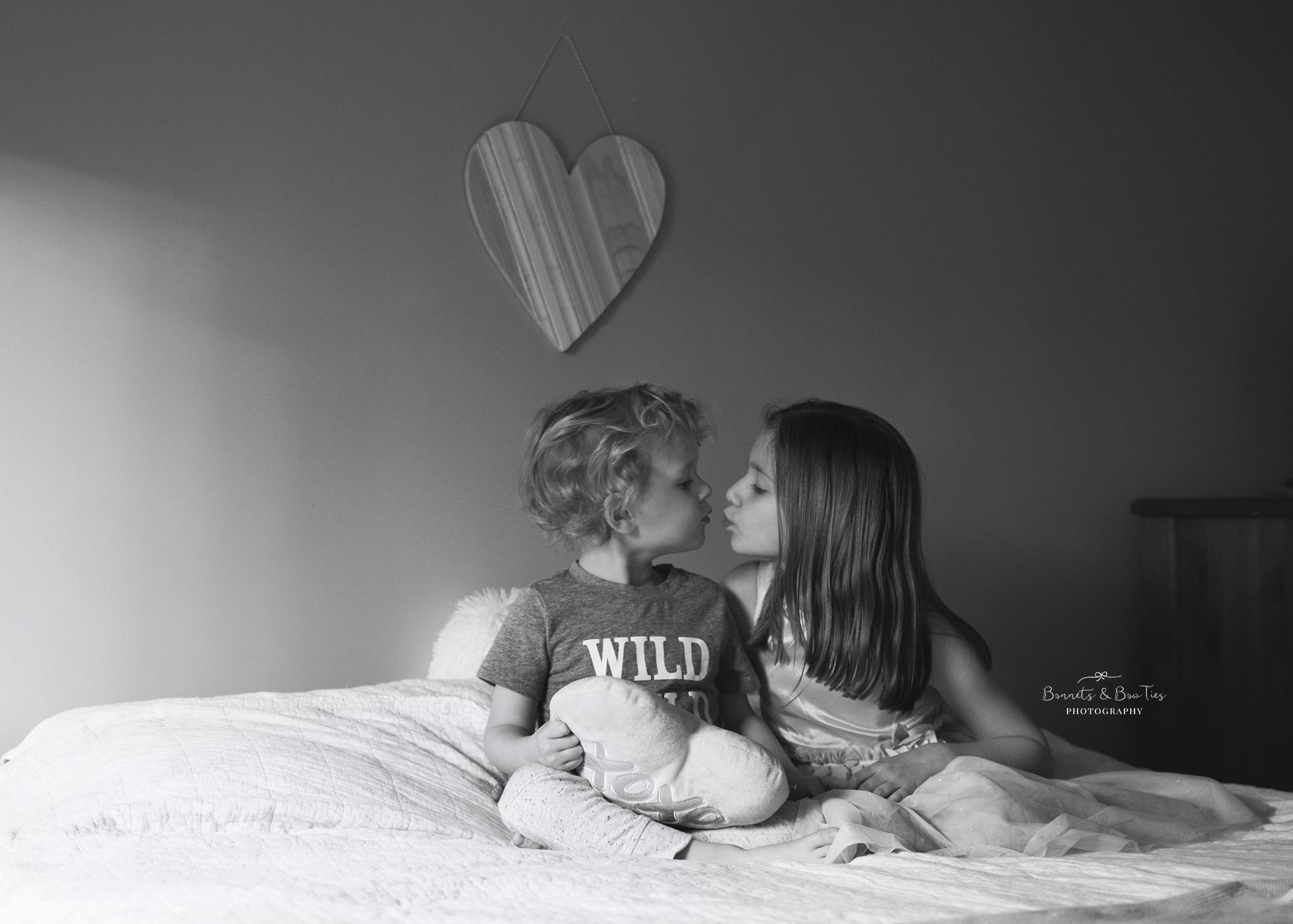 black and white sibling pose.jpg