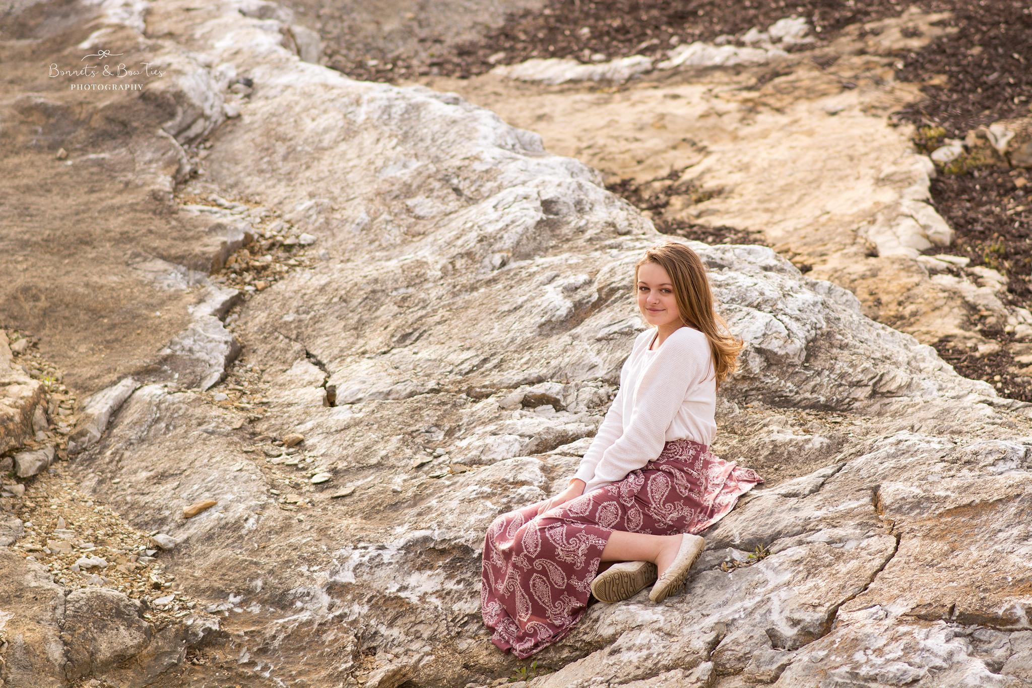 girl wearing white sitting on rocks.jpg