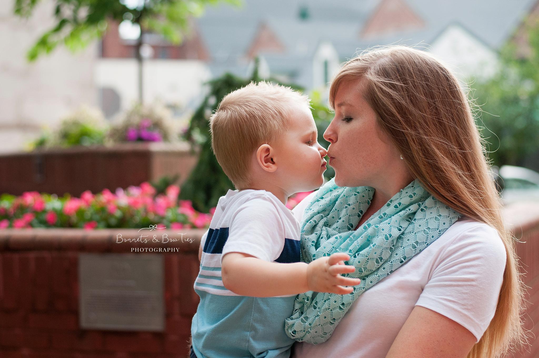 mommy kissing son.jpg