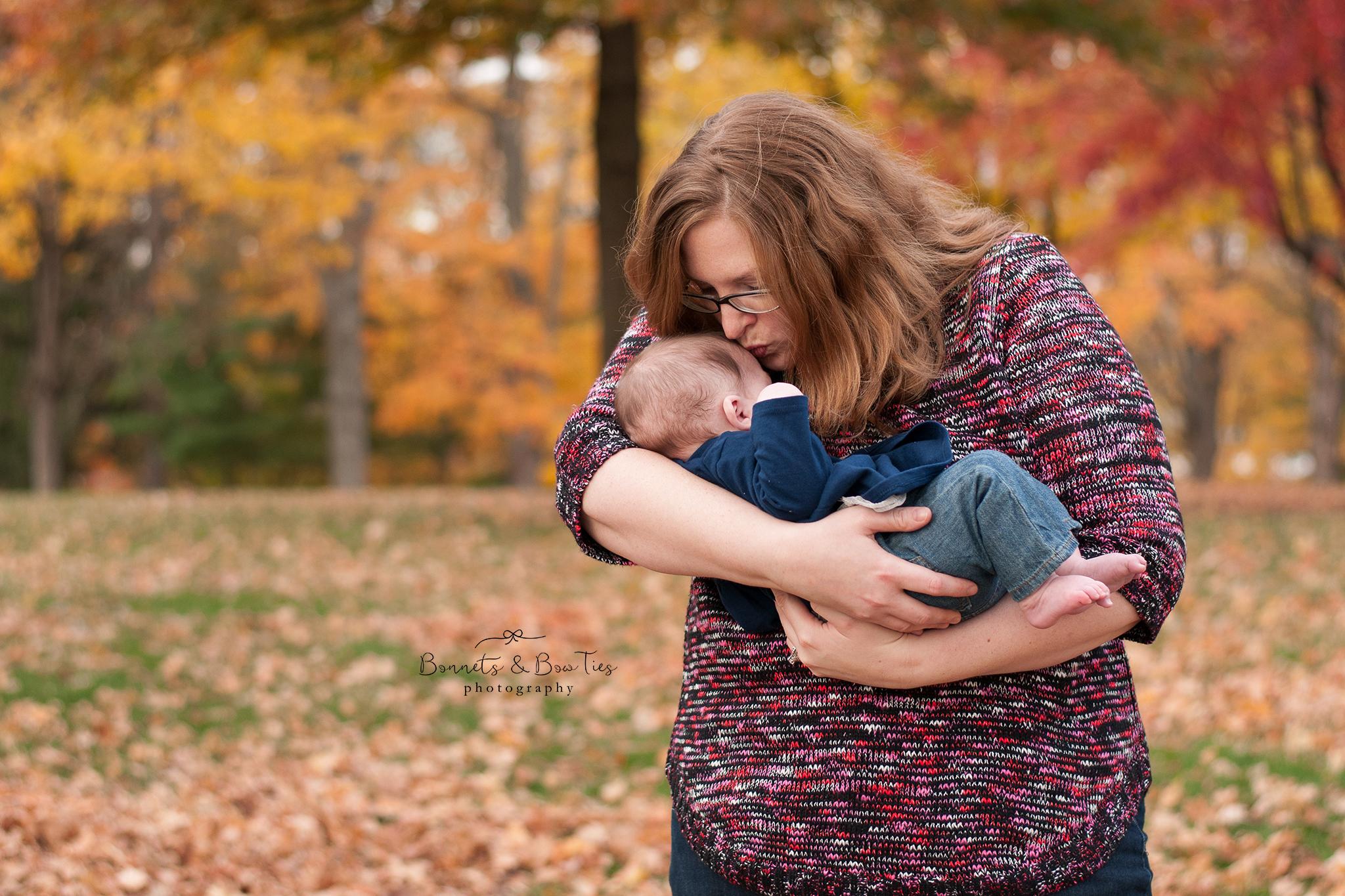 Mother kissing baby girl york pa photographer.jpg