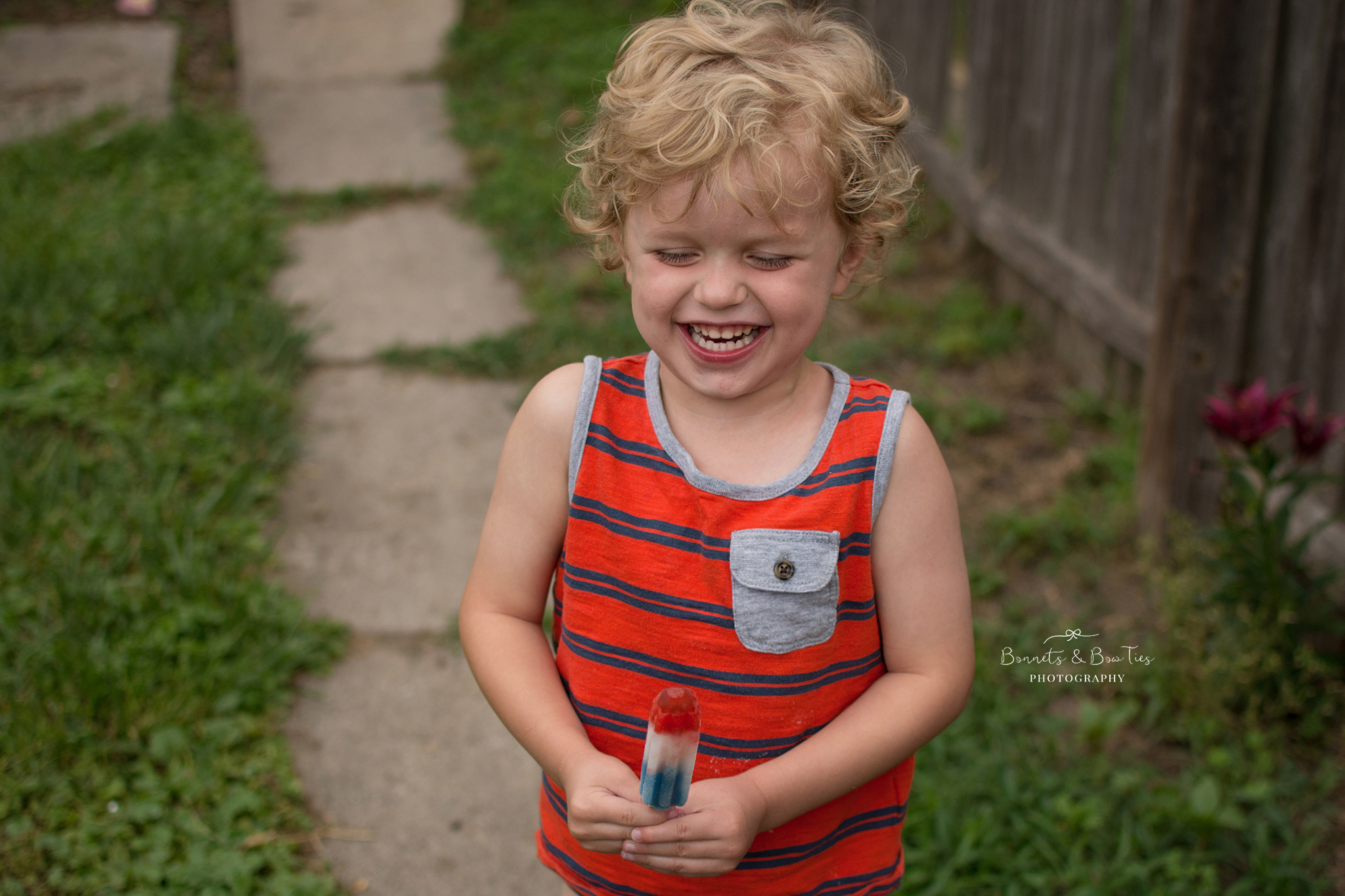 boy laughing holding a popsicle.jpg