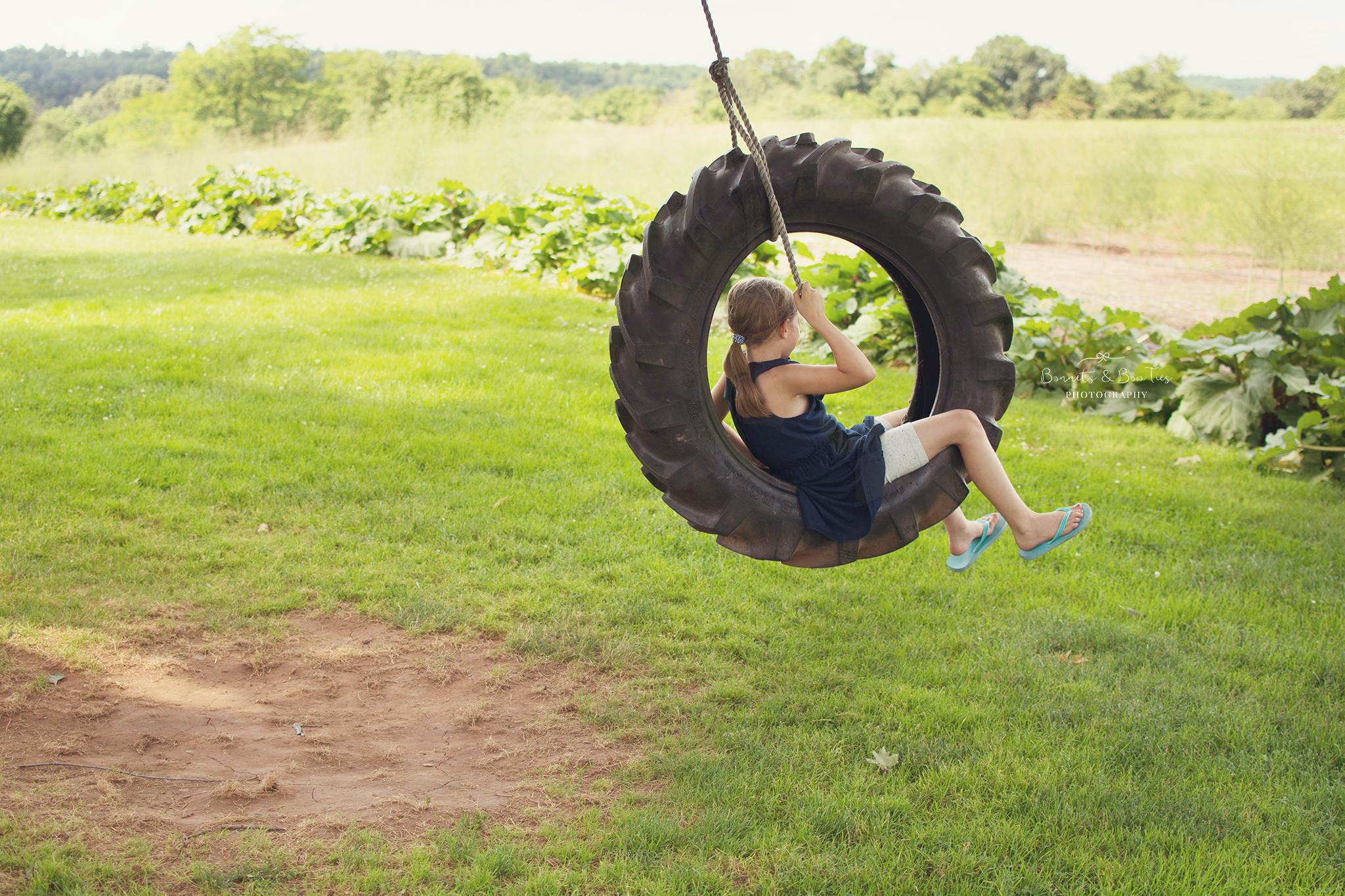 girl swinging on a trie swing.jpg