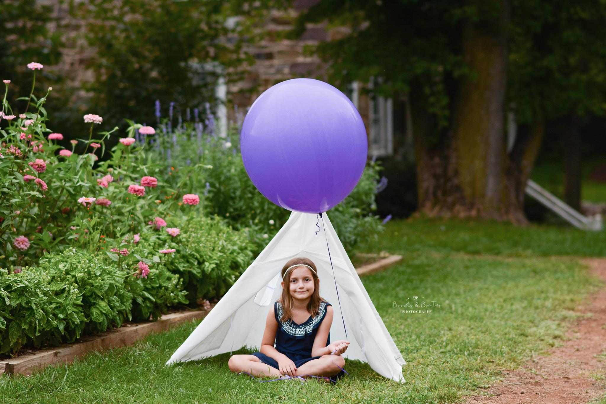 girl holding a purple balloon.jpg