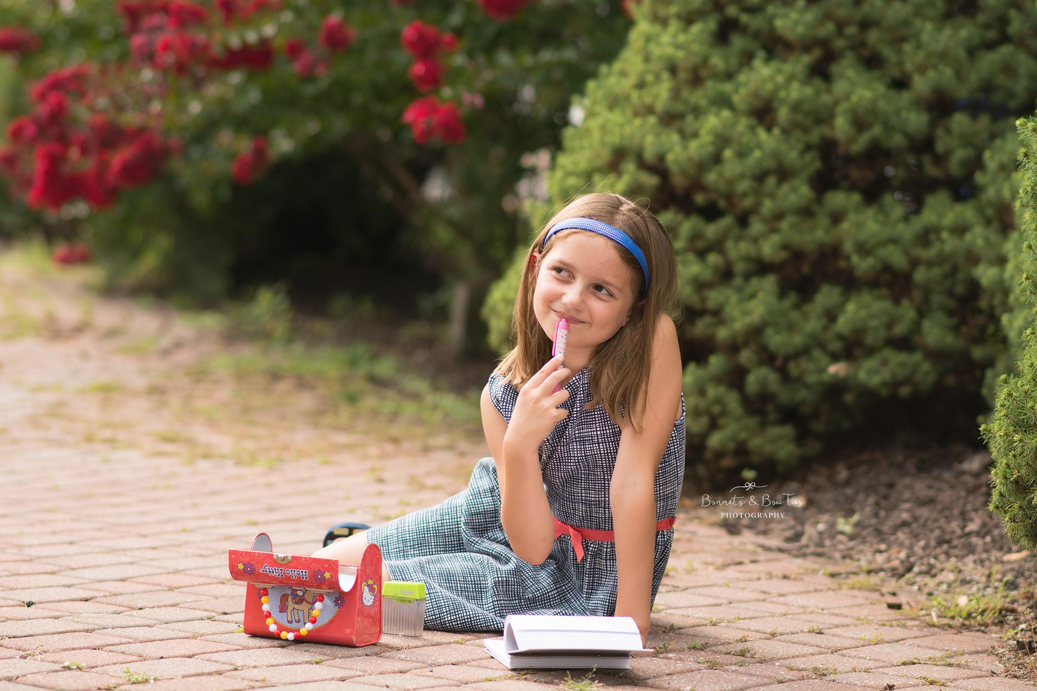 girl holding a pen.jpg