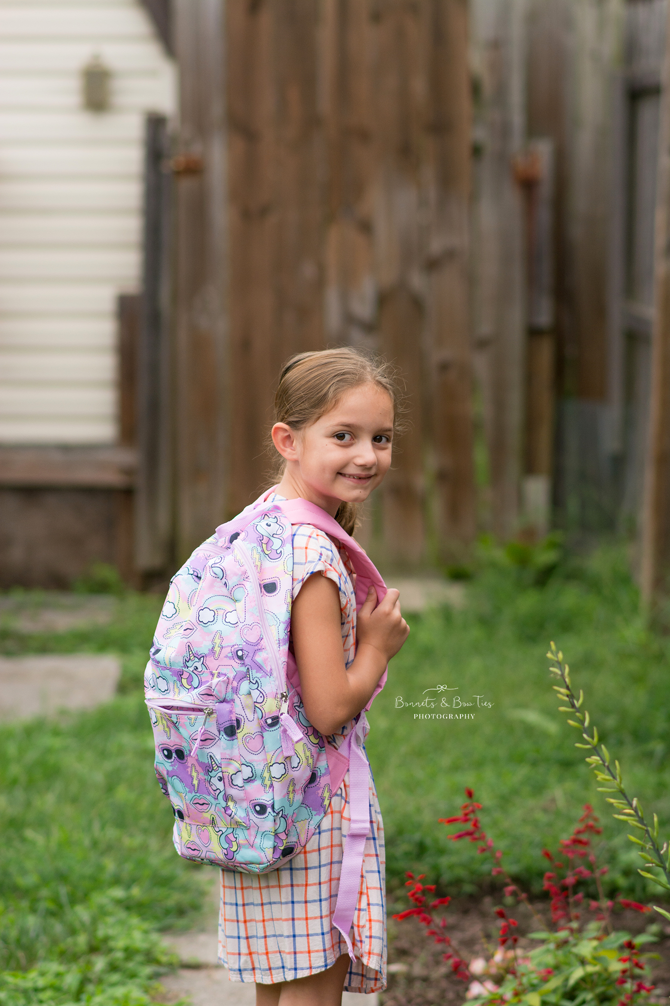 girl with purple backpack.jpg