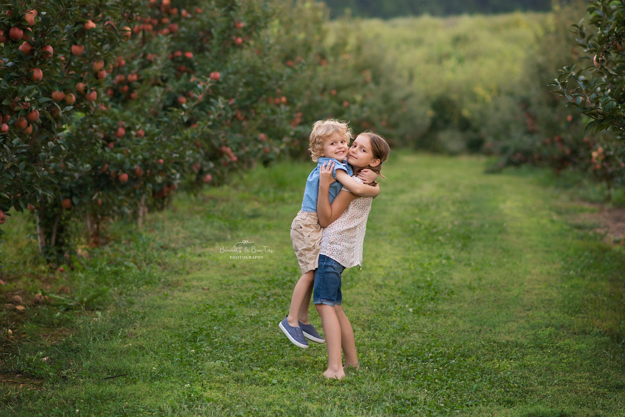 sibling pose at apple orchard
