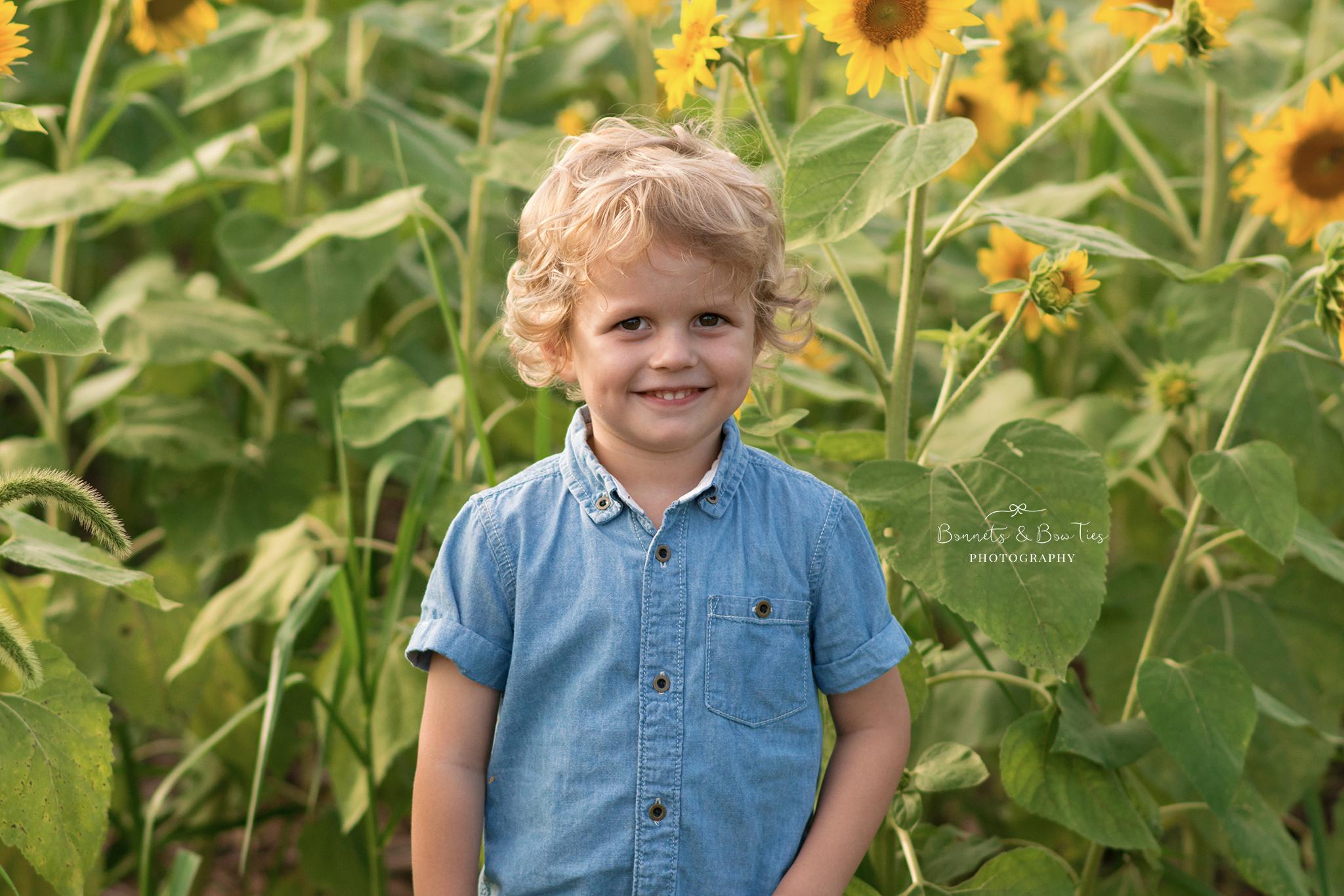 boy posing in sunflower field.jpg