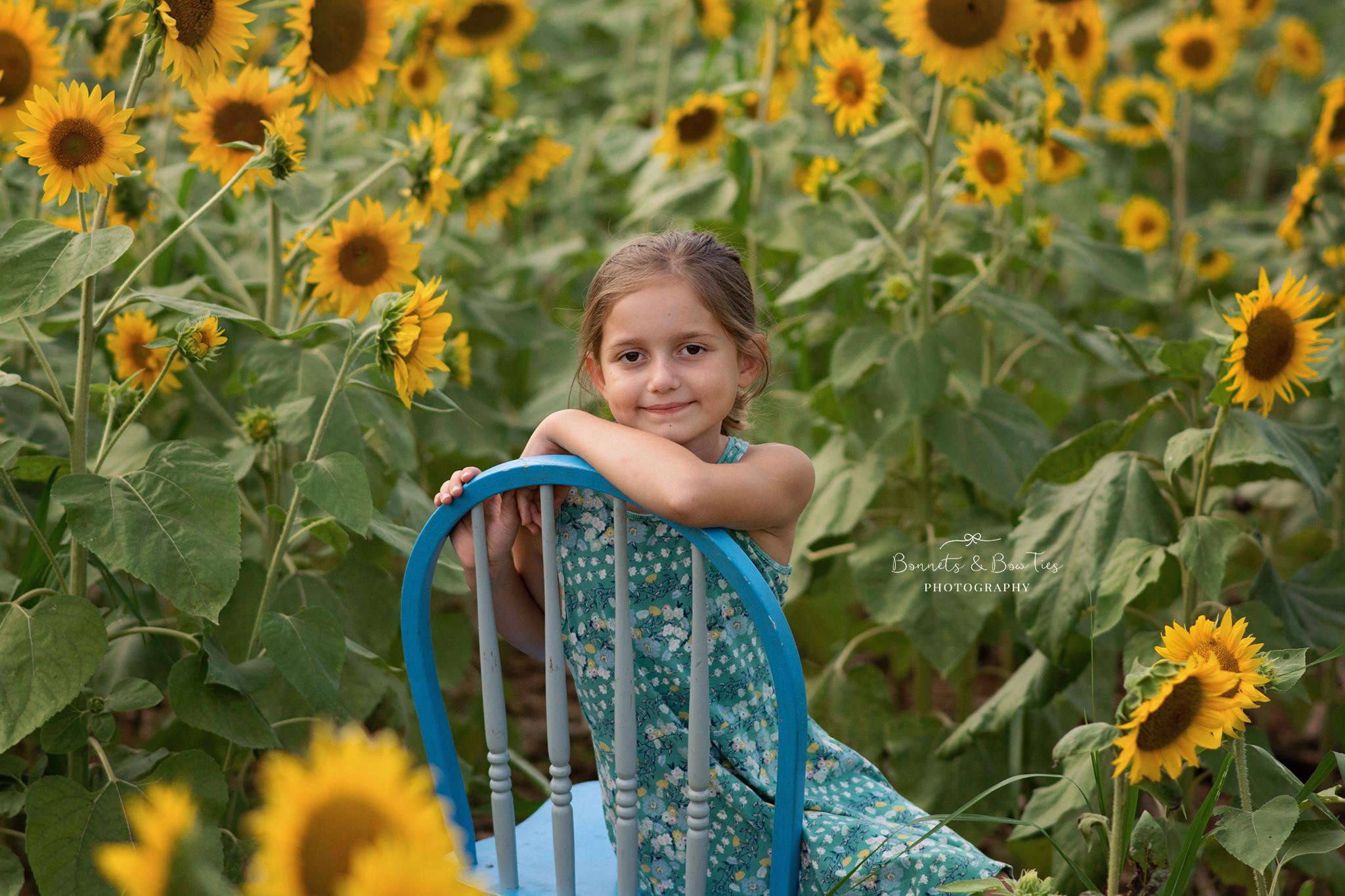 girl sitting on blue chair.jpg