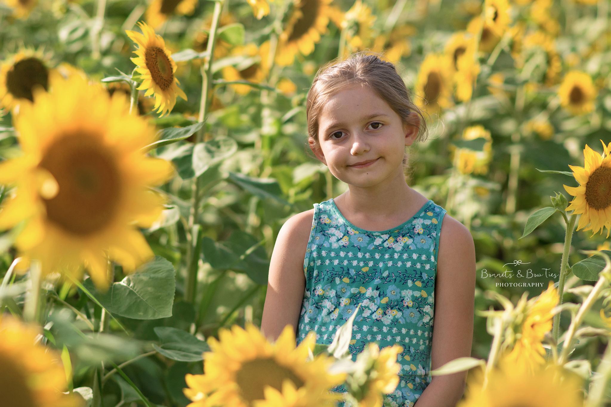 girl posing in sunflower field.jpg