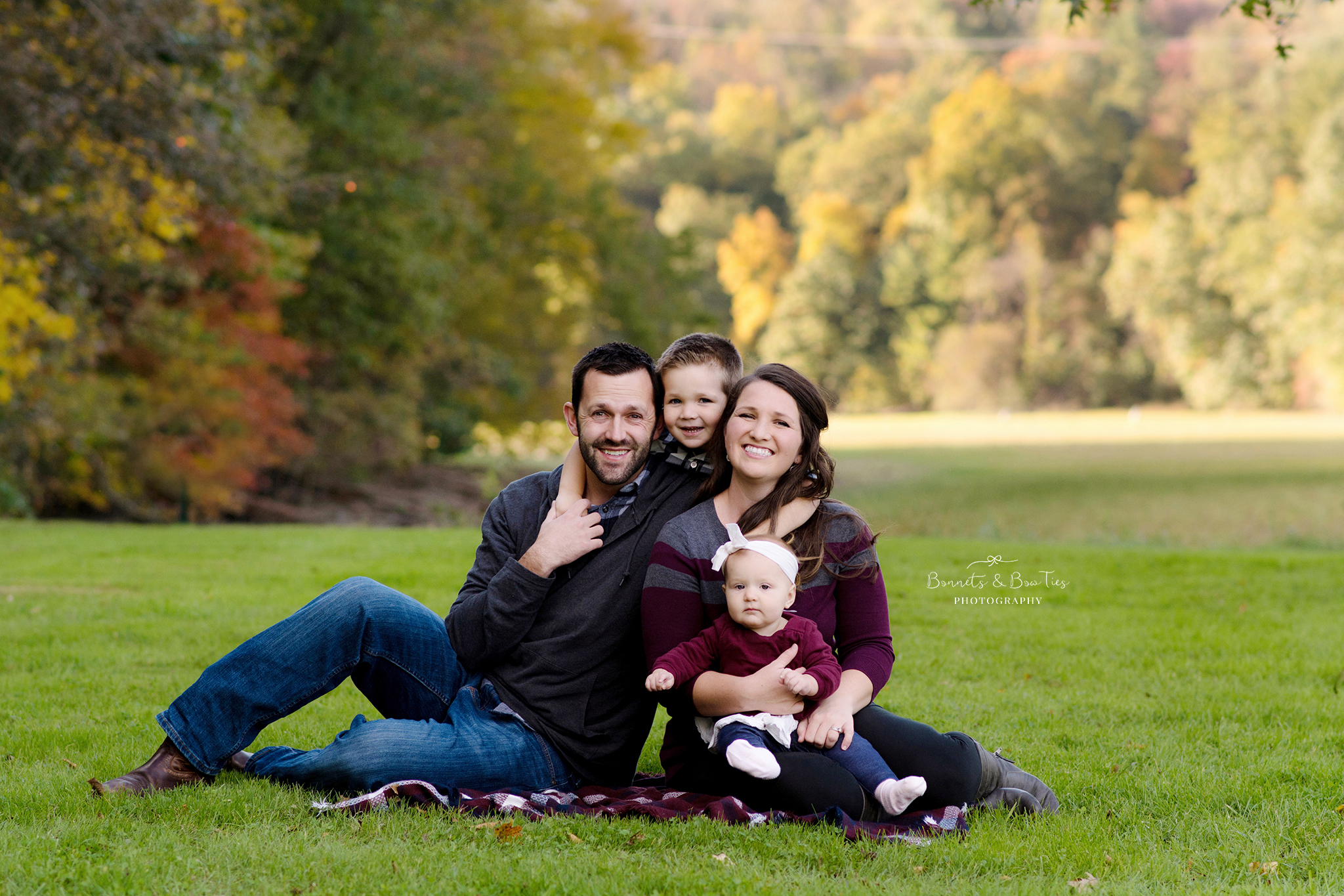 Family photo seated on grass.jpg