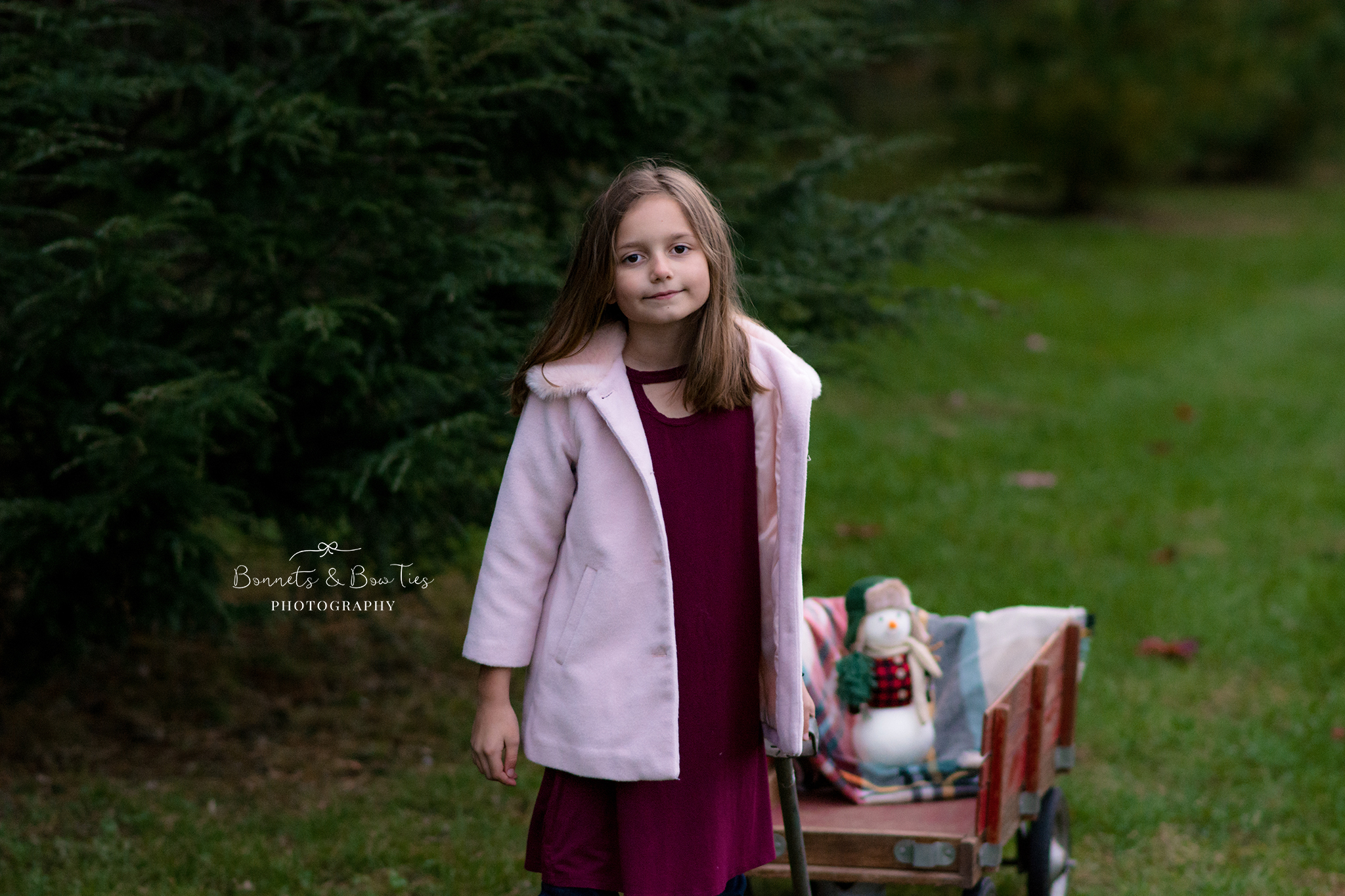 portrait of a girl wearing pink coat.jpg