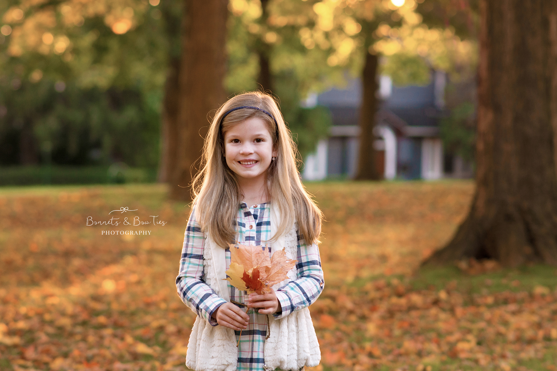 girl poses holding leaf.jpg