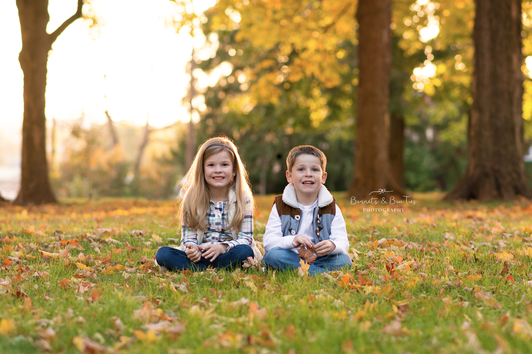 boy and girl pose in leaves.jpg
