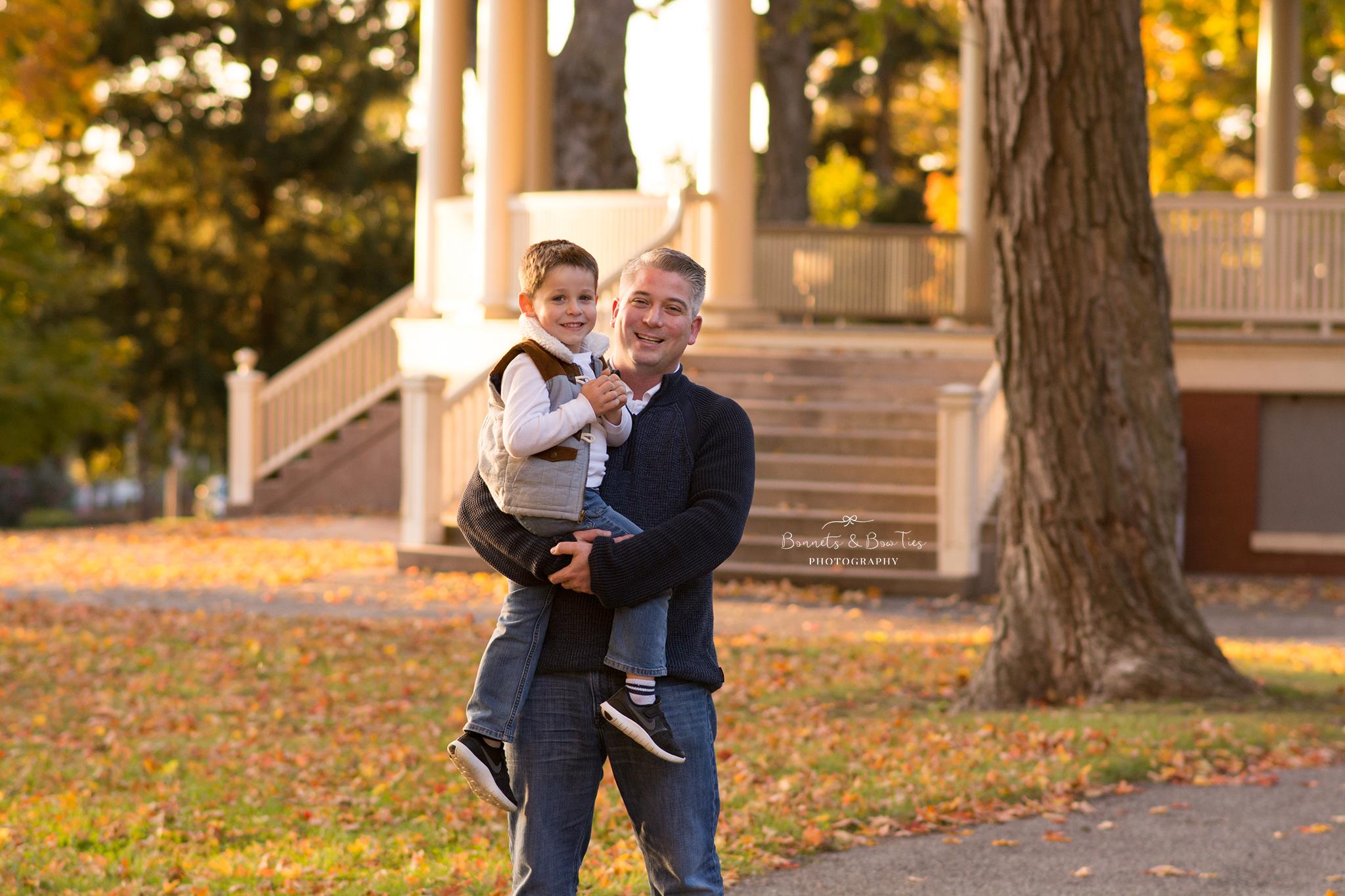 daddy and son pose near gazebo.jpg