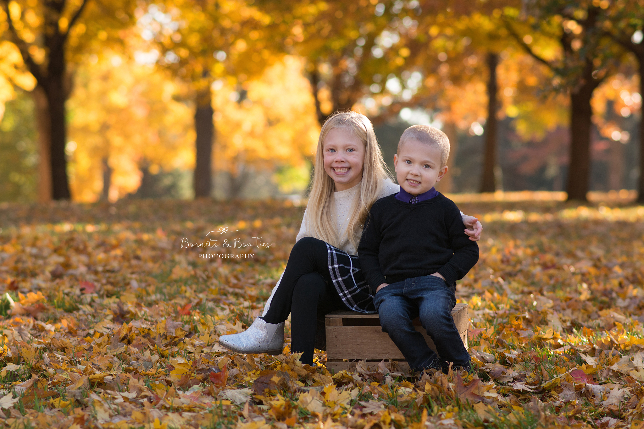 sibling pose during fall photo session.jpg