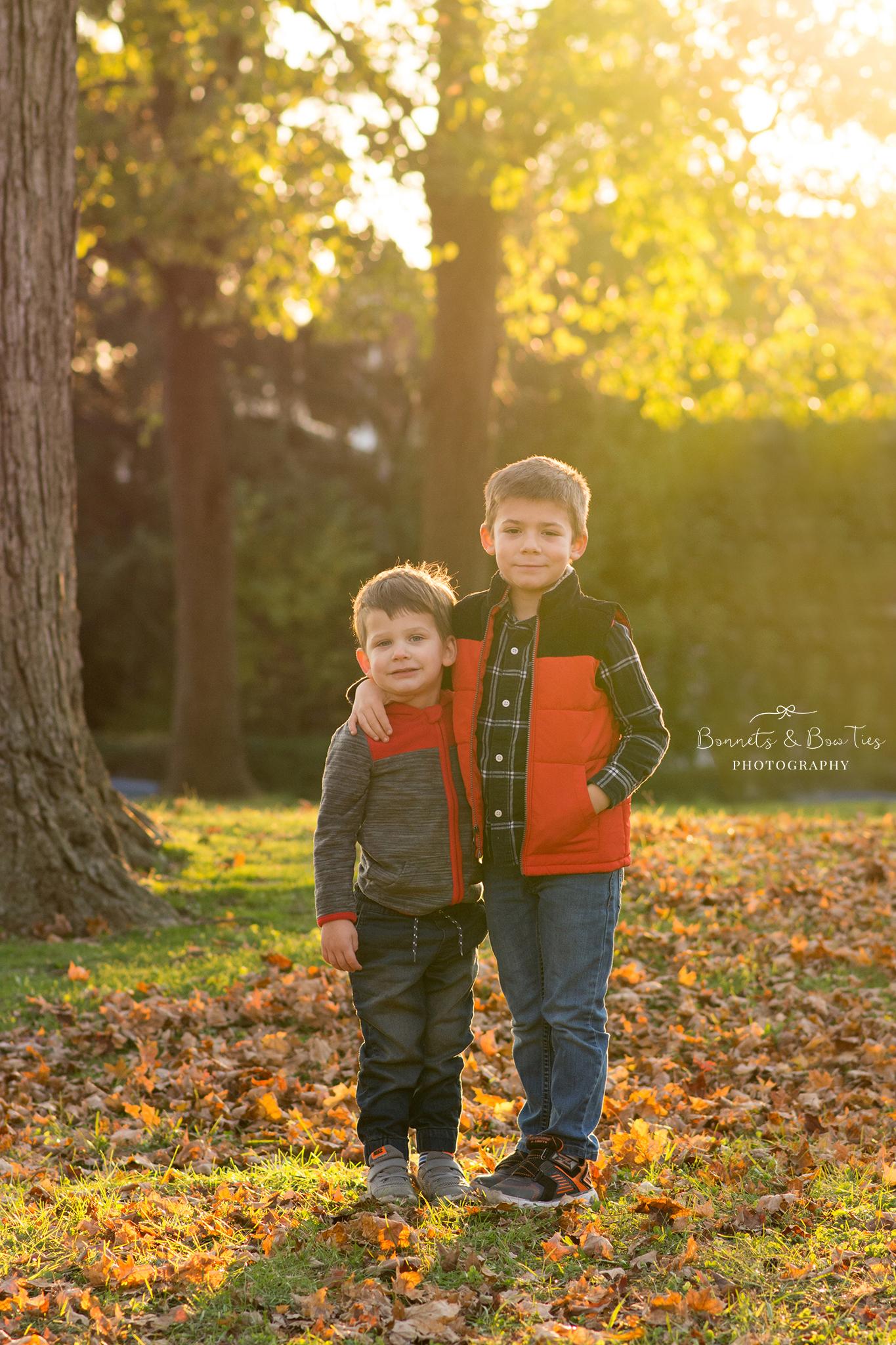 boys pose for family photo shoot.jpg
