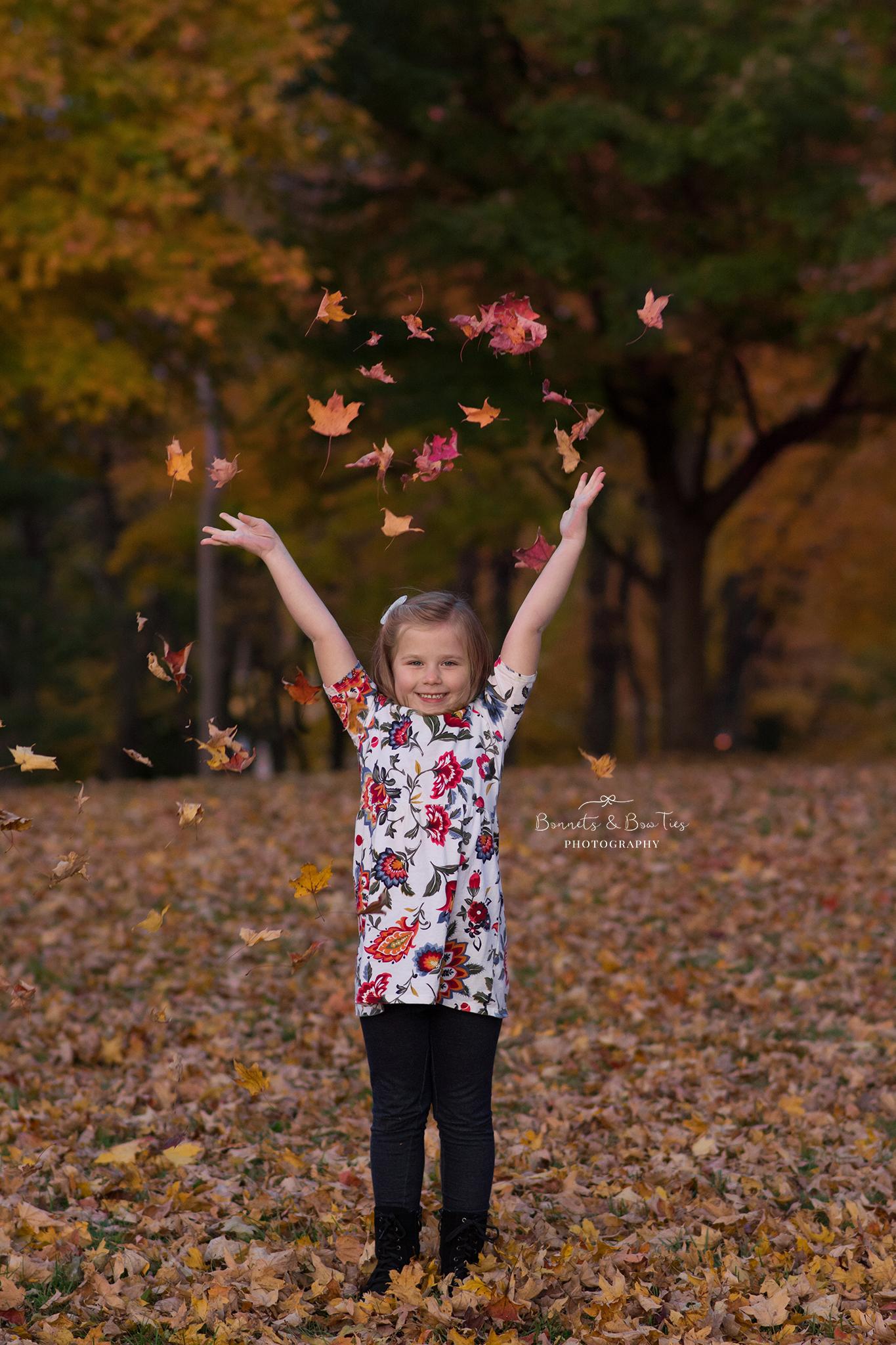 girl throwing leaves.jpg
