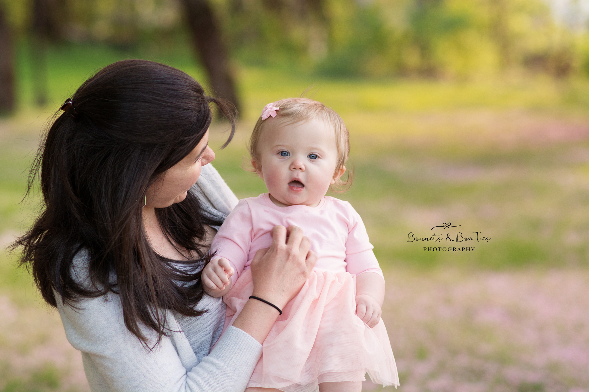 mommy holding baby girl wearing pink.jpg
