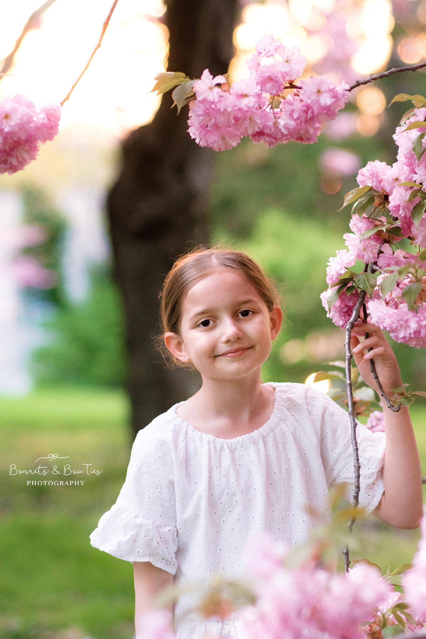 girl wearing white dress in cherry blossoms.jpg