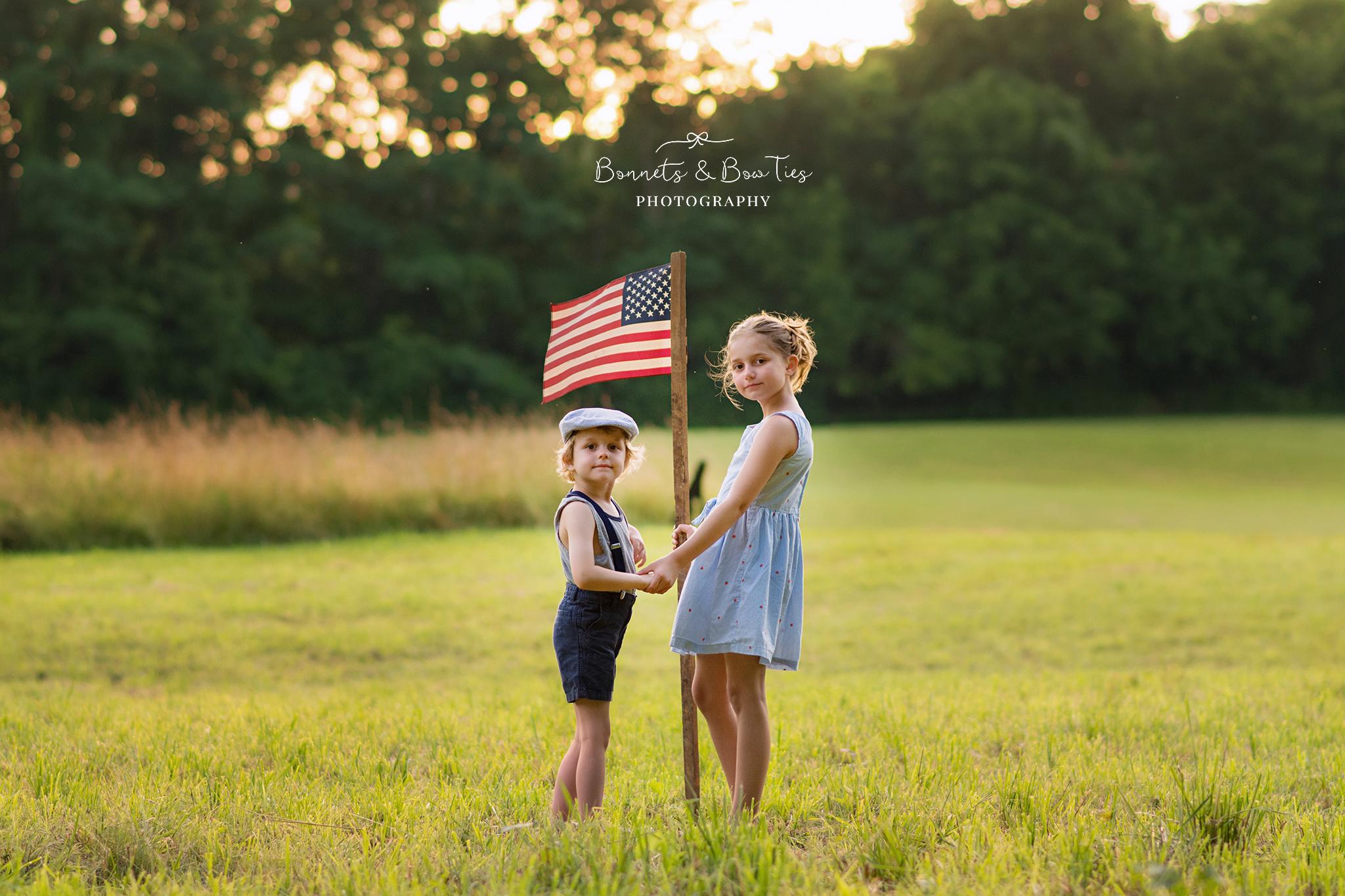 boy and girl pose with amercian flag.jpg