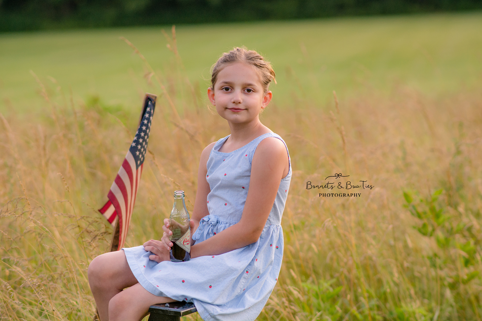 girl wearing blue dress poses for july 4th.jpg